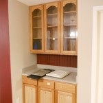 Antique white cabinets with brown glaze before photo