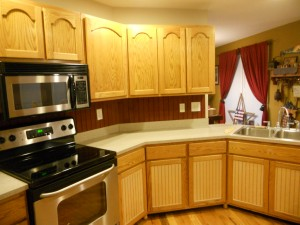 "A ""before"" photo of this kitchen shows the contrast of changing the cabinet color."