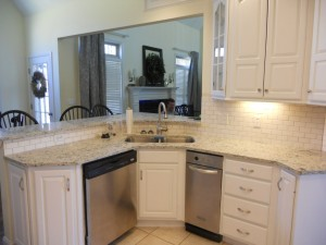 Cool white painted kitchen cabinets