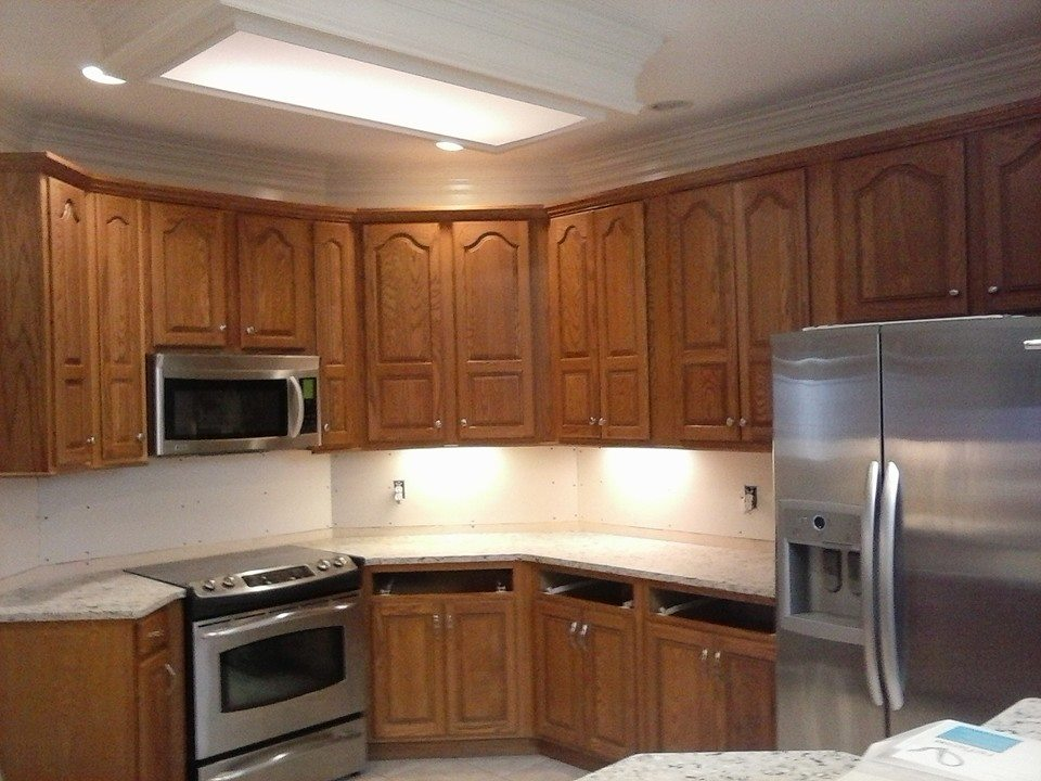 Cool white painted kitchen cabinets before