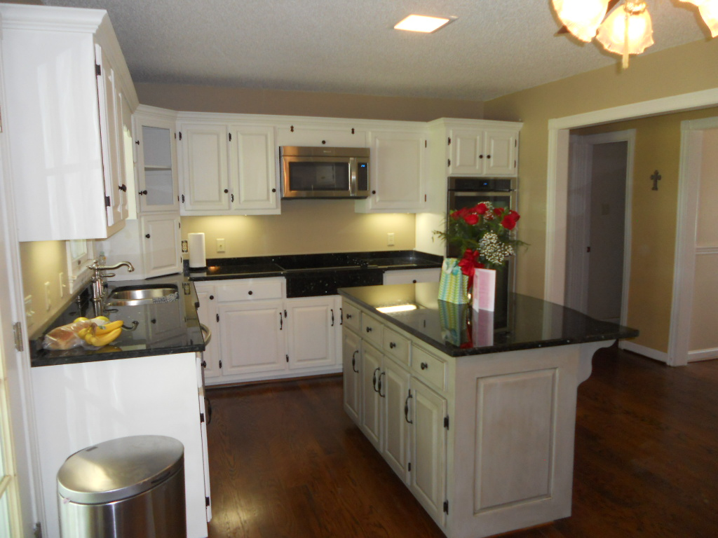 An after photo of this project with painted kitchen cabinets and contrasting island.