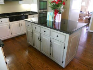 An after photo of this project with painted kitchen cabinets with contrasting island.