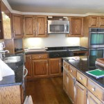 A before photo of this project with painted kitchen cabinets and contrasting island.
