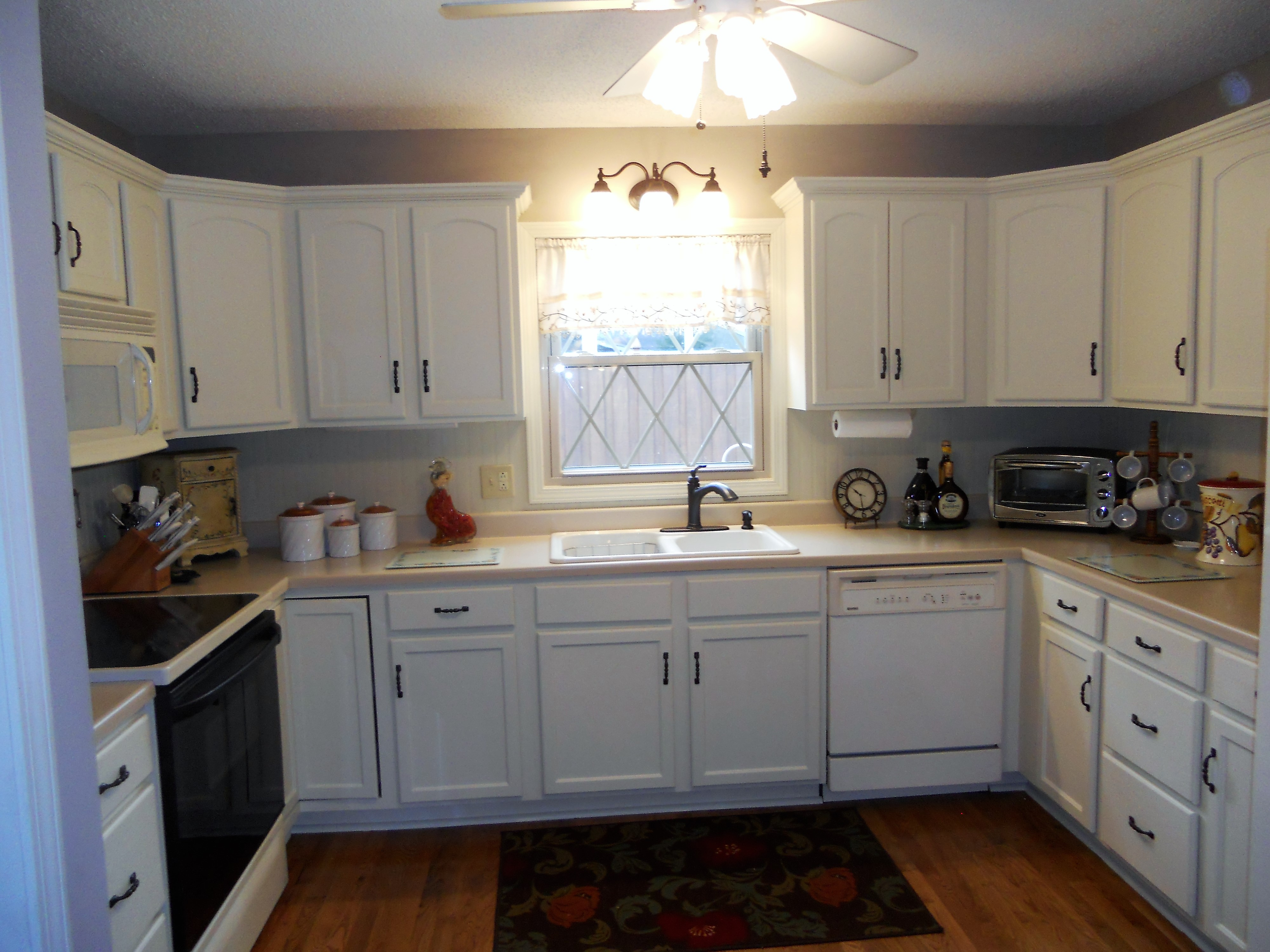 Antique white painted kitchen cabinets after jan 2016 07 for Painting kitchen cabinets
